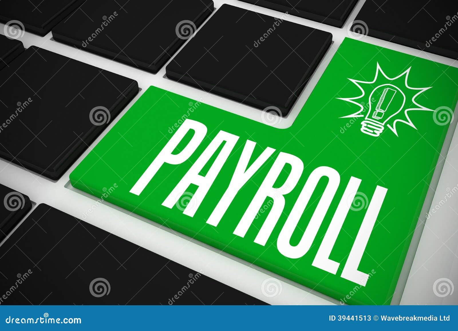 Nómina de pago en el teclado negro con llave verde