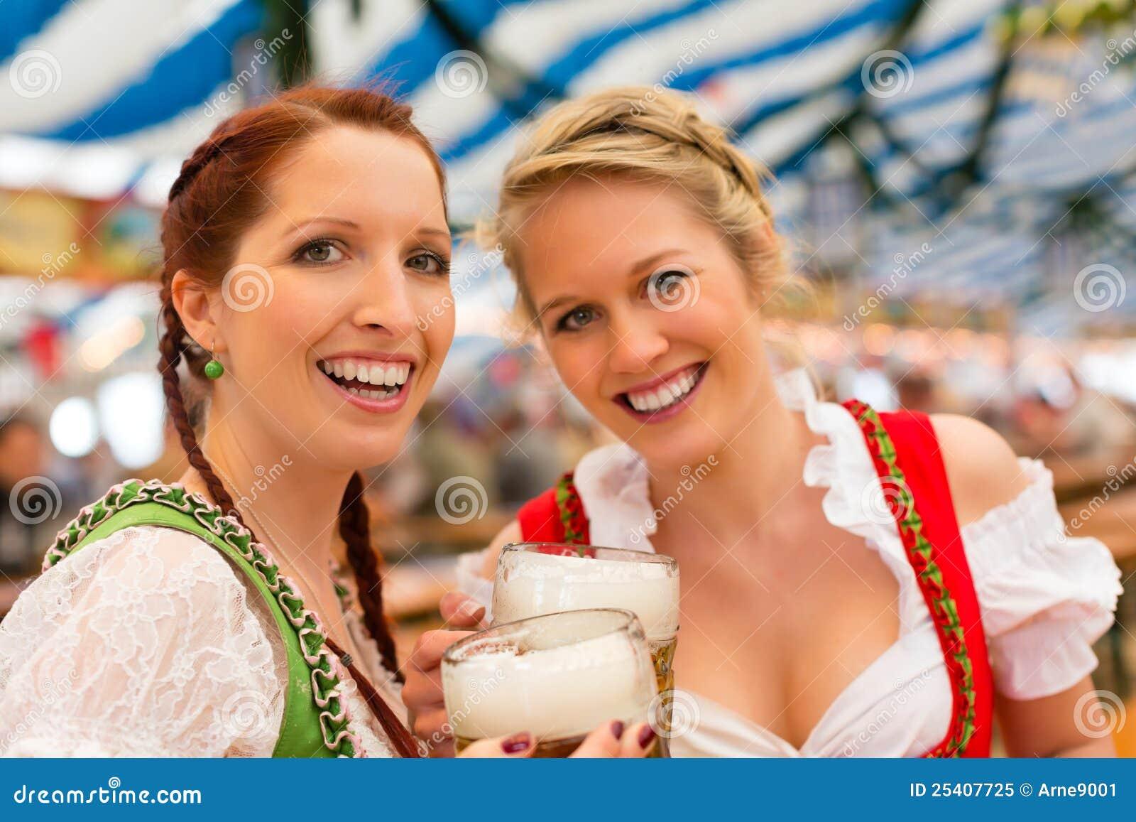 N with Bavarian dirndl in beer tent