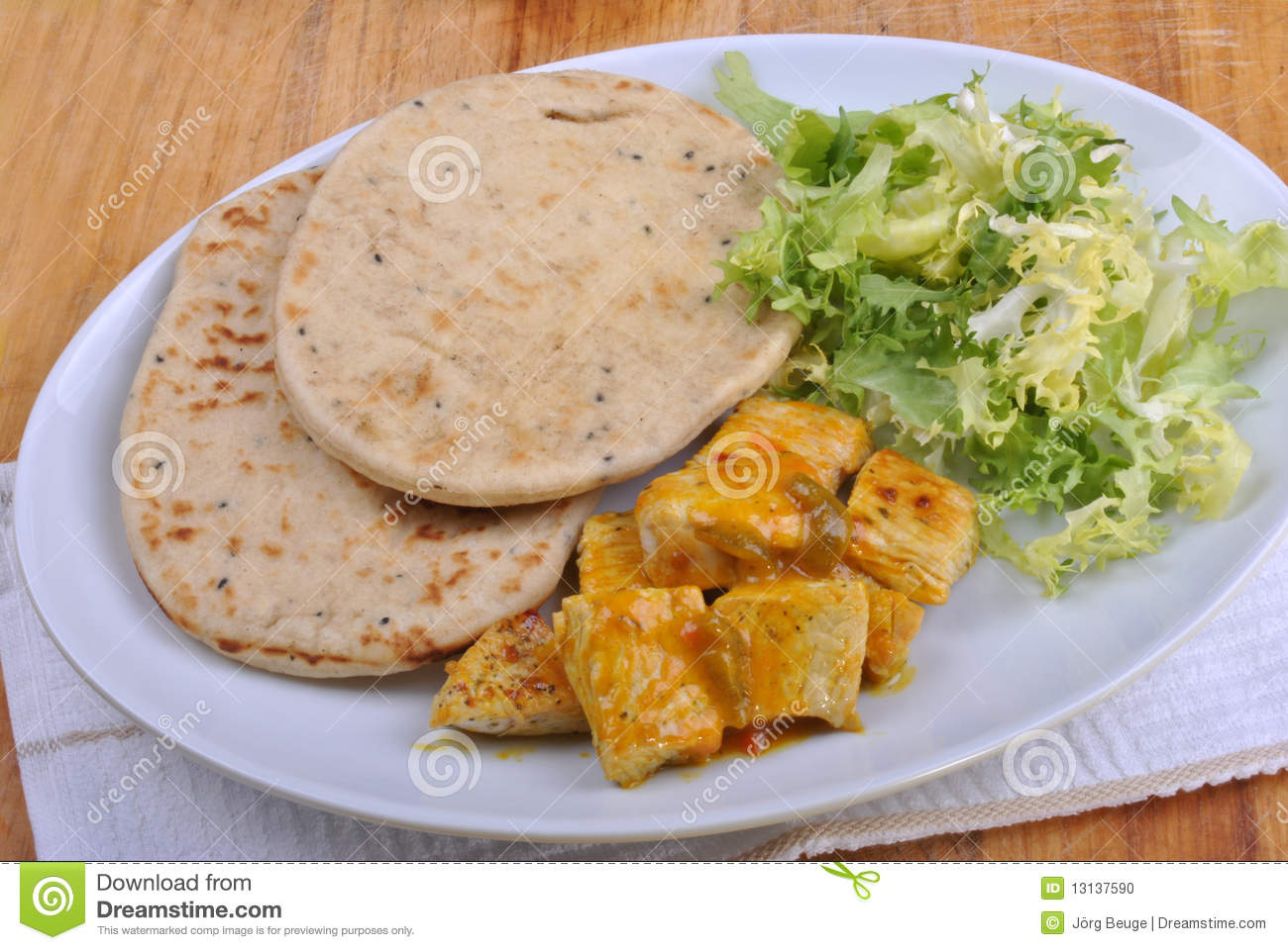Naan bread with turkey curry