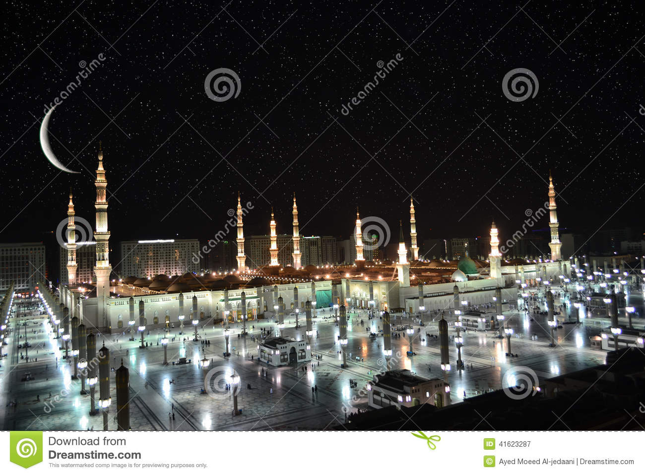 Nabawi Mosque in Medina and crescent at night time