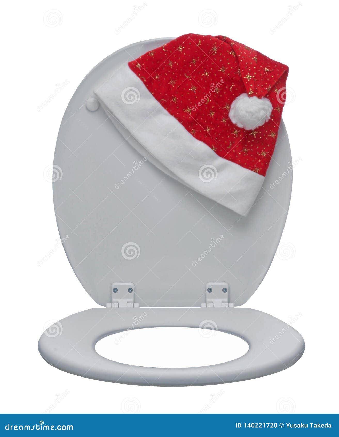 Nahaufnahme der weißen Toilettenschüssel und des Santa Claus-Hutes