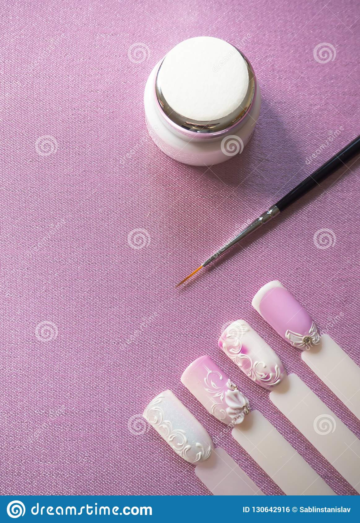Nail Design Paint Brushes And Types On Pink Background Stock