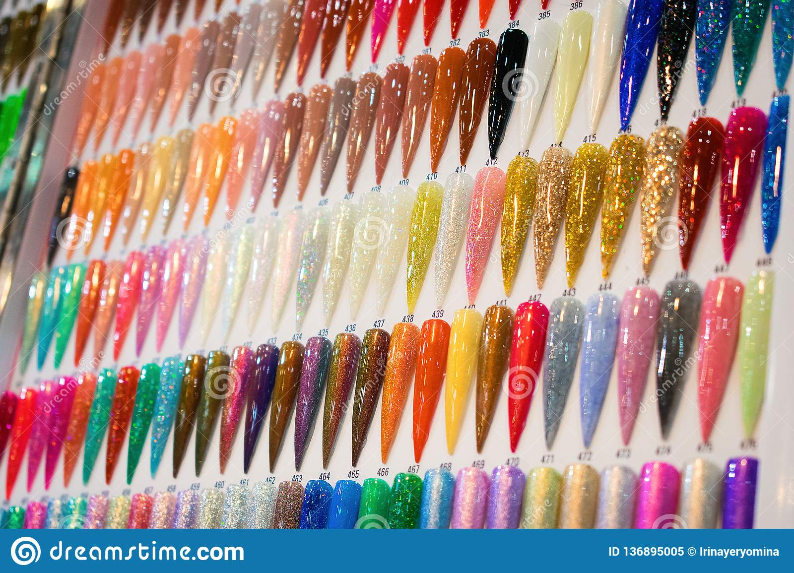 Nail Polish Color Charts. Nail polish swatches in different color. Colorful nail lacquer in tips. Shiny gel lacquer