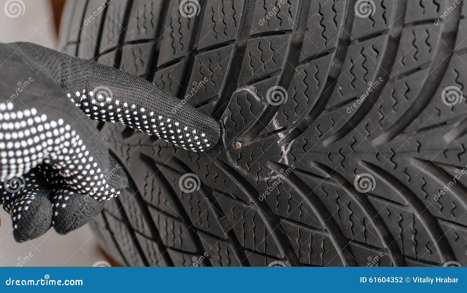 Nail In Tyre Stock Photo 61604352 - Megapixl