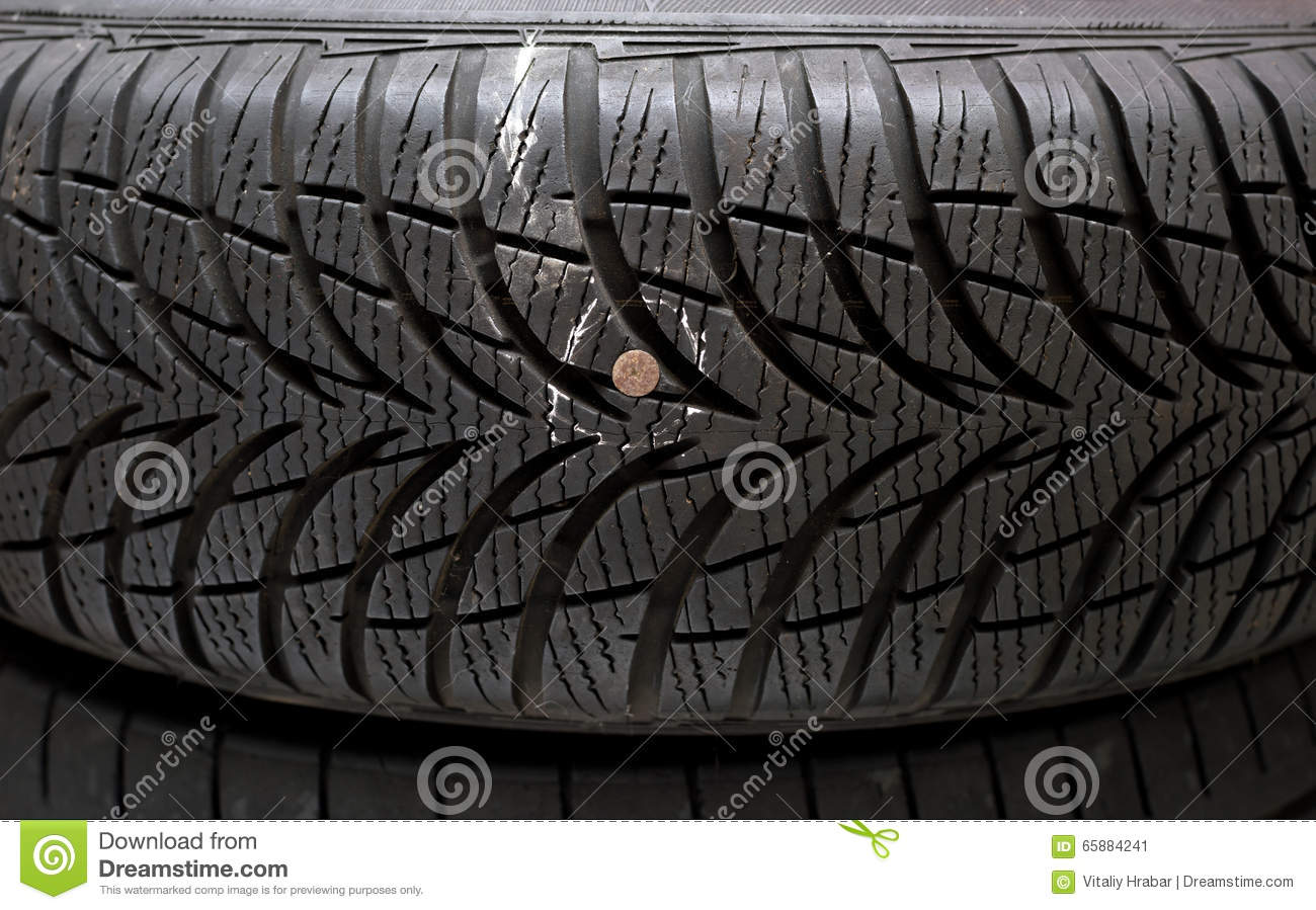 Nail in tyre stock image. Image of pattern, curing, tread - 65884241