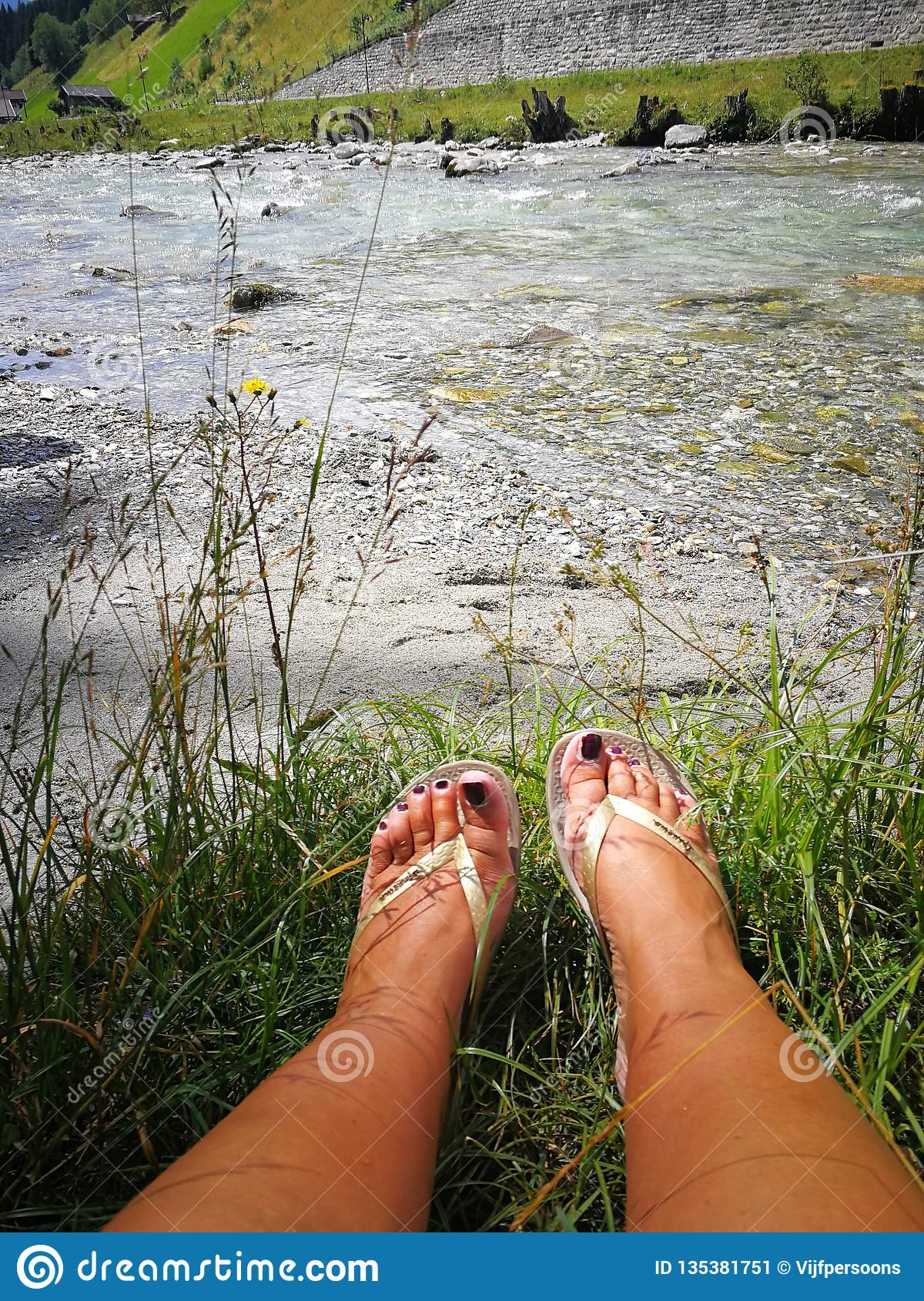 Feet by the river