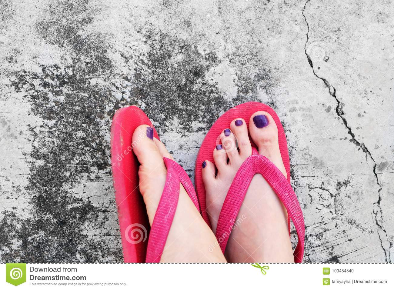 3568fd256117 Nails Pedicure. Selfie Woman s Sandals Feet with Violet Nail Pedicure of  Paint on Cement Background