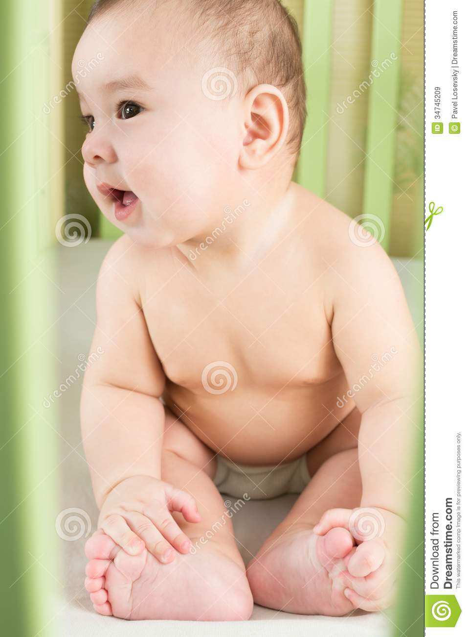 Download Naked Baby In A Diaper Sitting Stock Image - Image of little, hand: 34745209