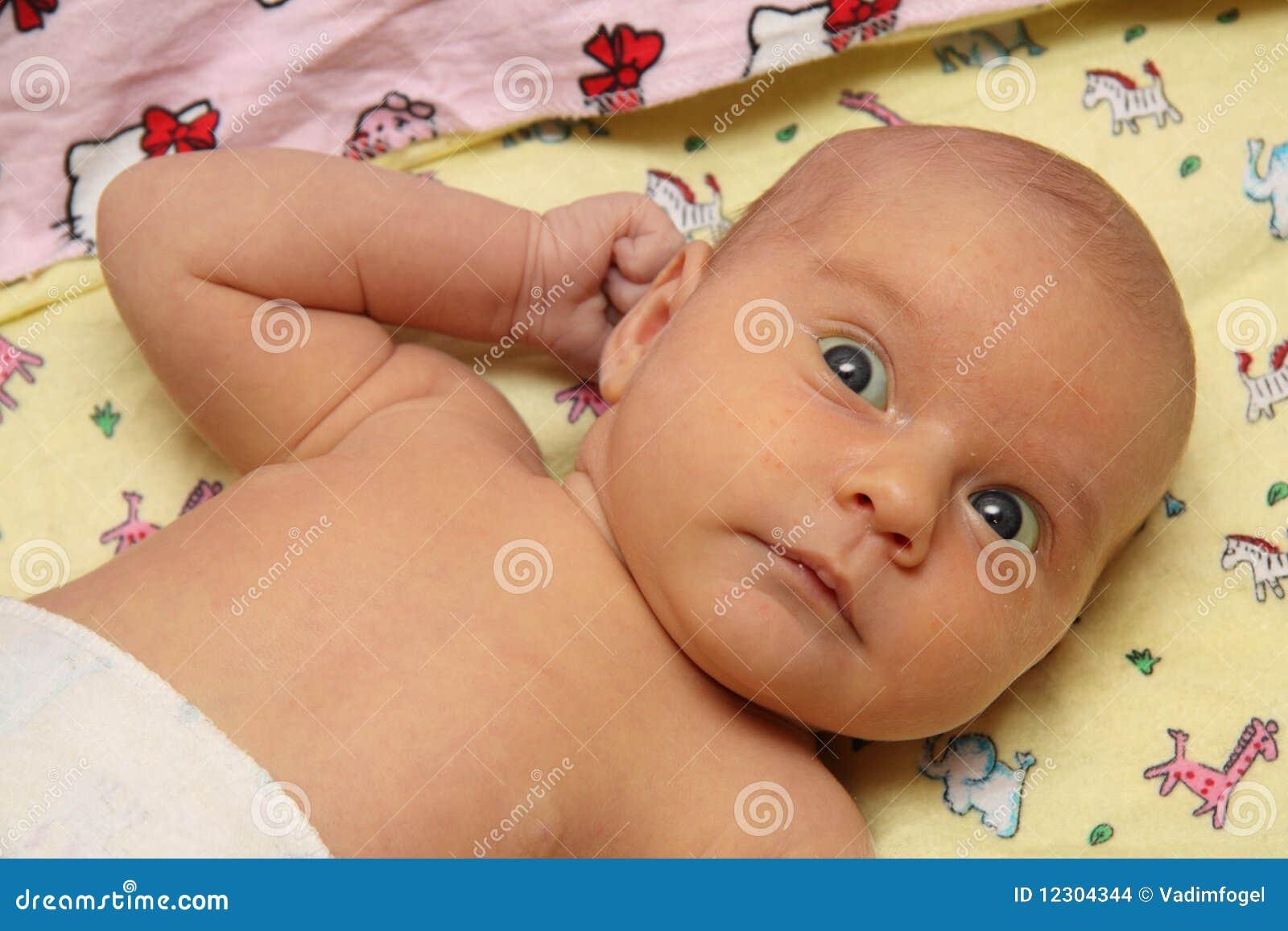 Pretty naked baby-girl lying on white - Shutterstock