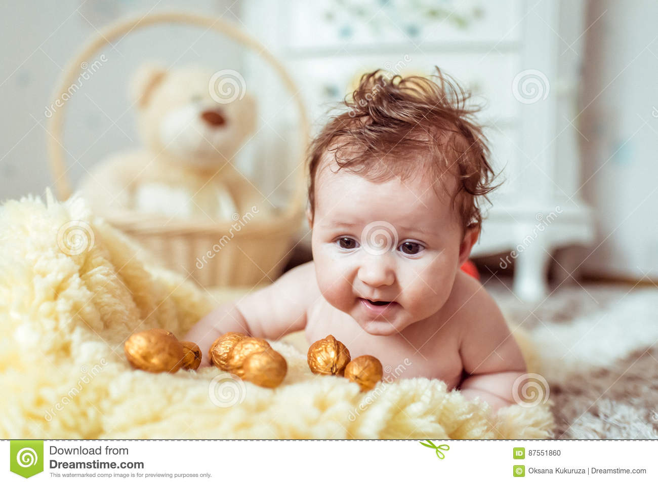 Royalty-Free photo: Naked baby on top of white textile