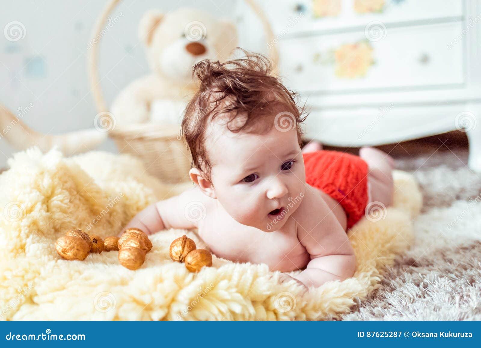 Naked Baby Lying On Blanket Stock Photo - Image of healthy