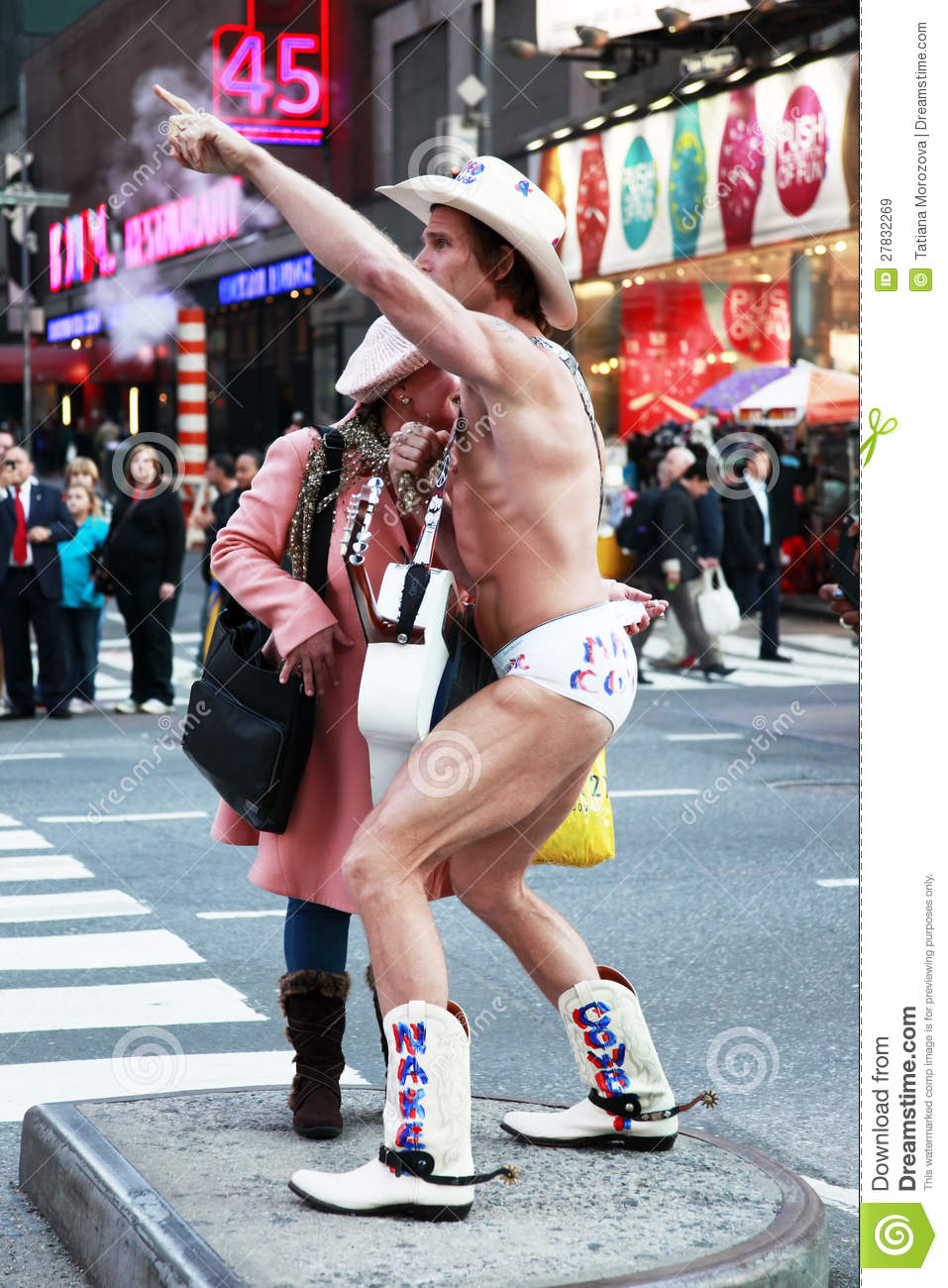 Naked Cowboy Showing Muscles On Times Square New York