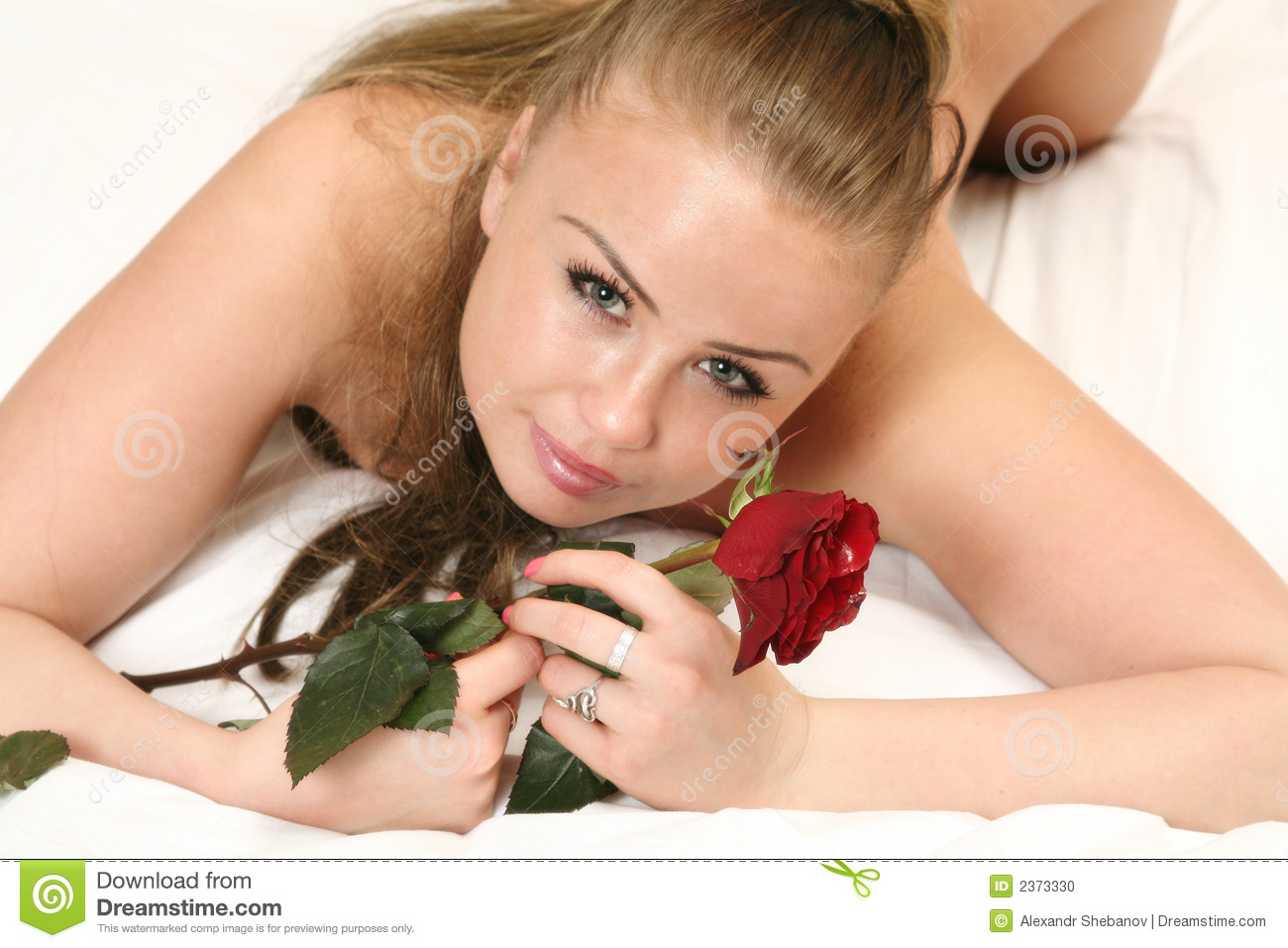Naked Girl On Bed With Rose Stock Image