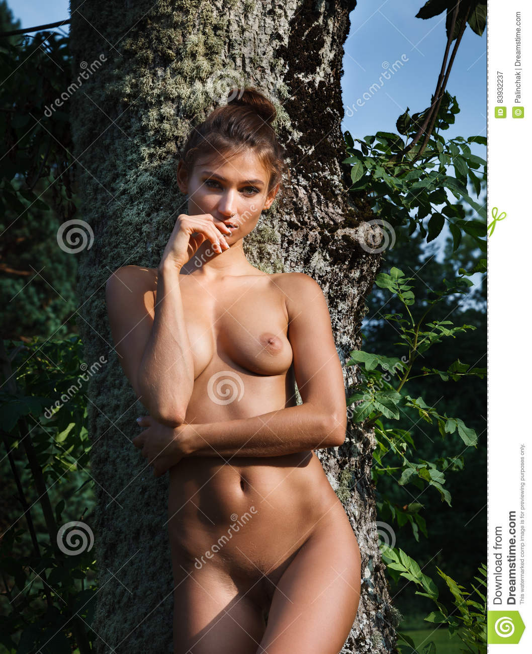 Naked girl outside with toys consider