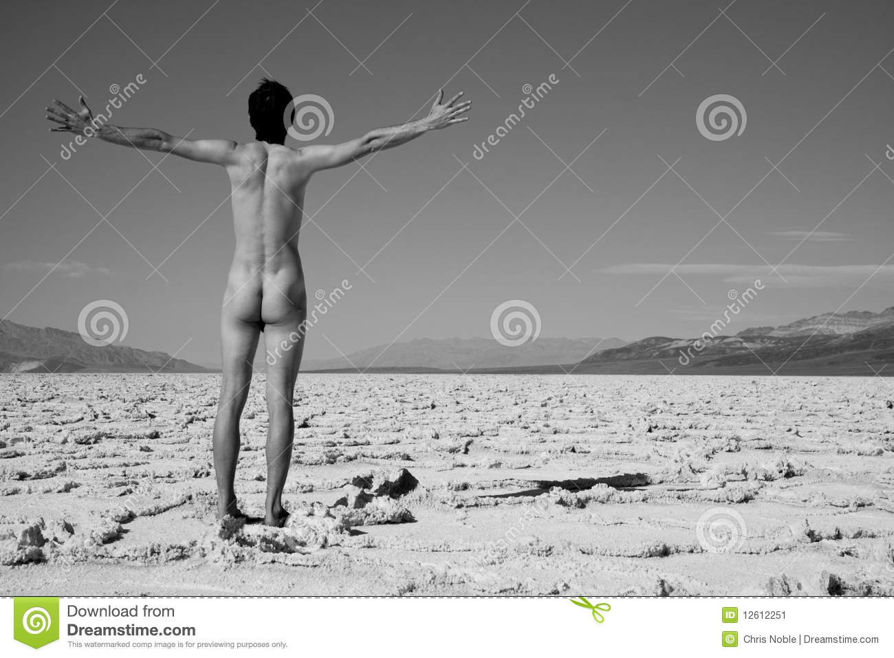 Naked man walking in Death Valley. Download preview