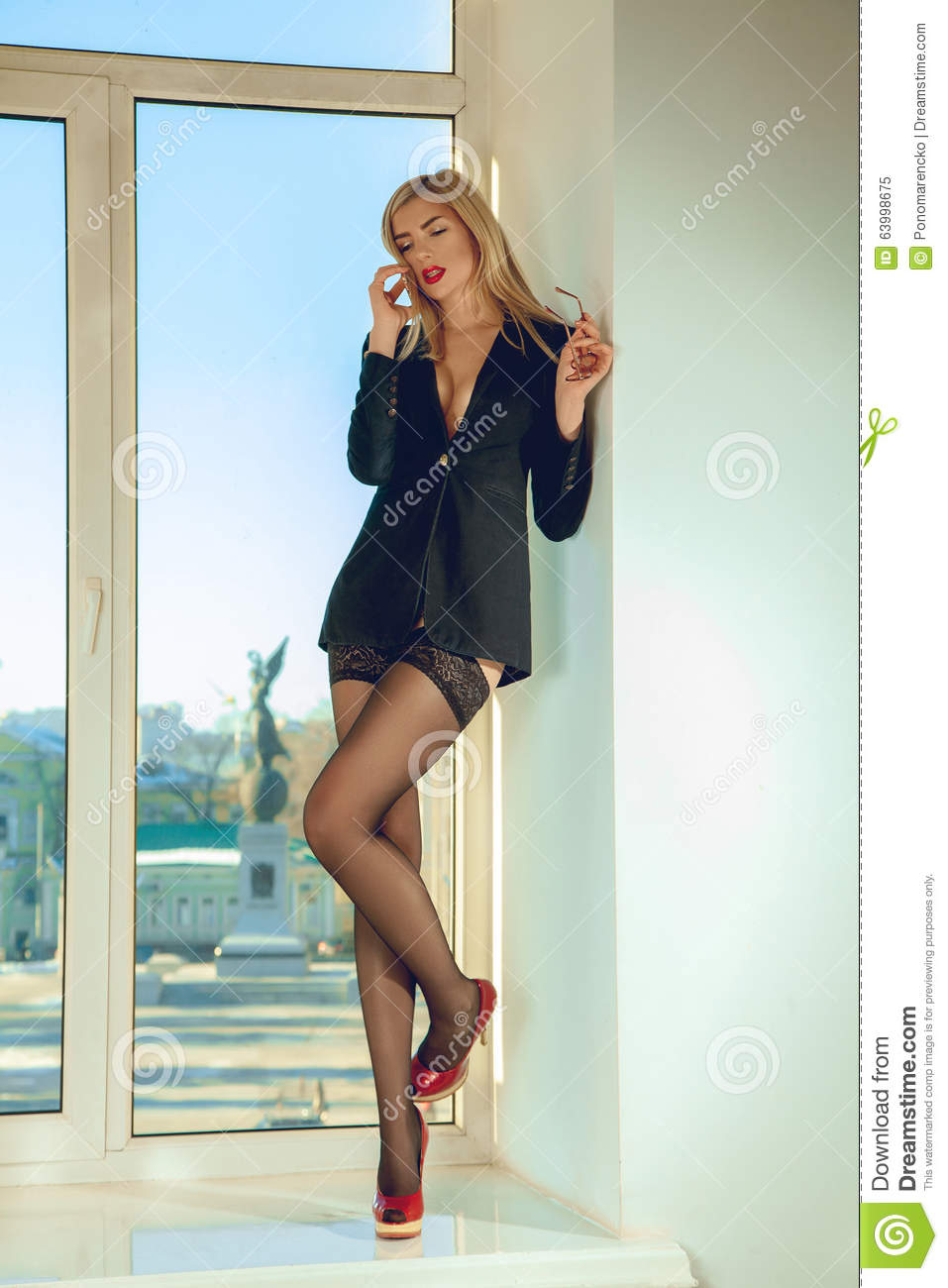 Almost Naked Secretary Talking On The Phone While Standing