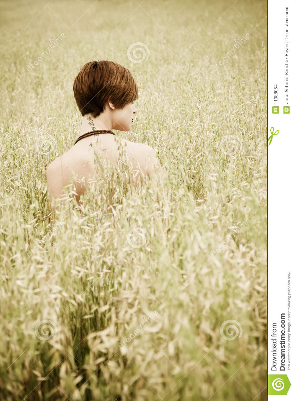 Naked woman on meadow