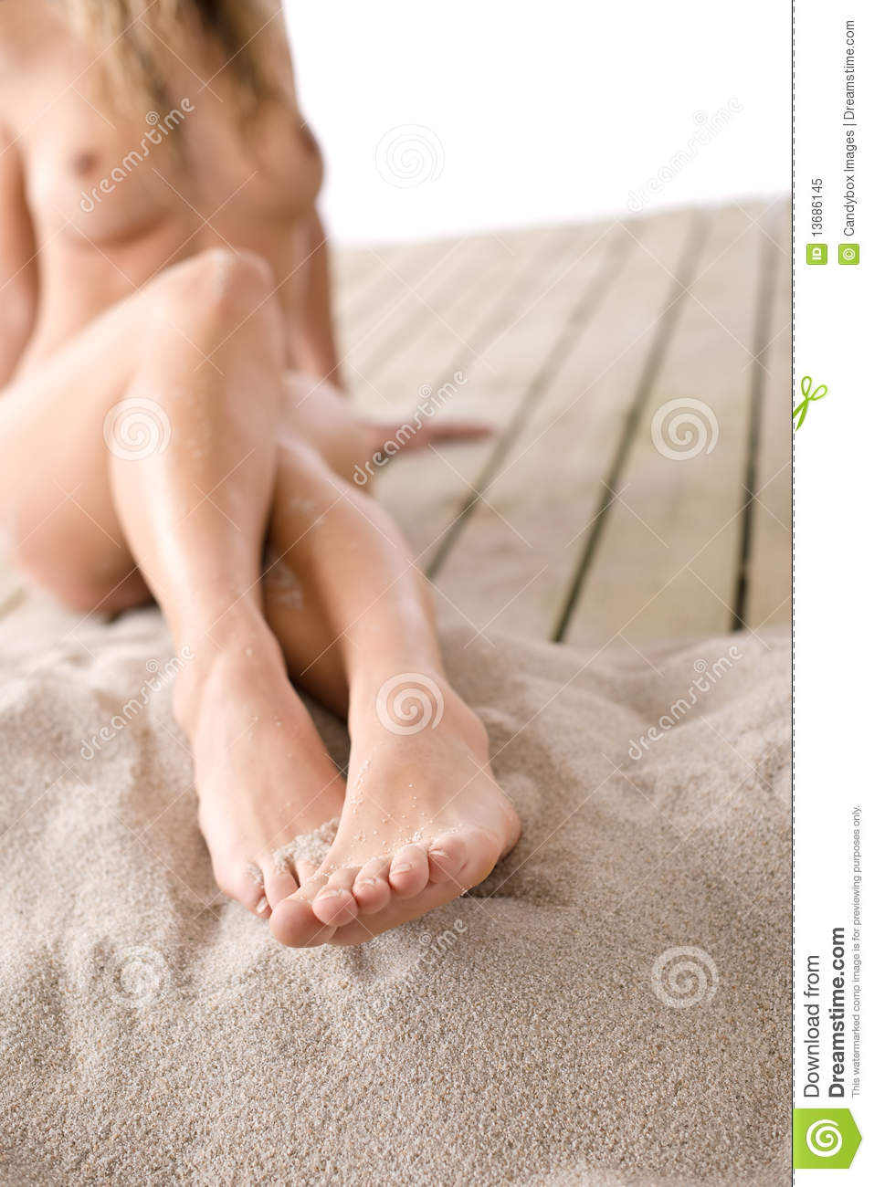 Part Of Naked Female Body On Beach Woman Sunbathing Covered