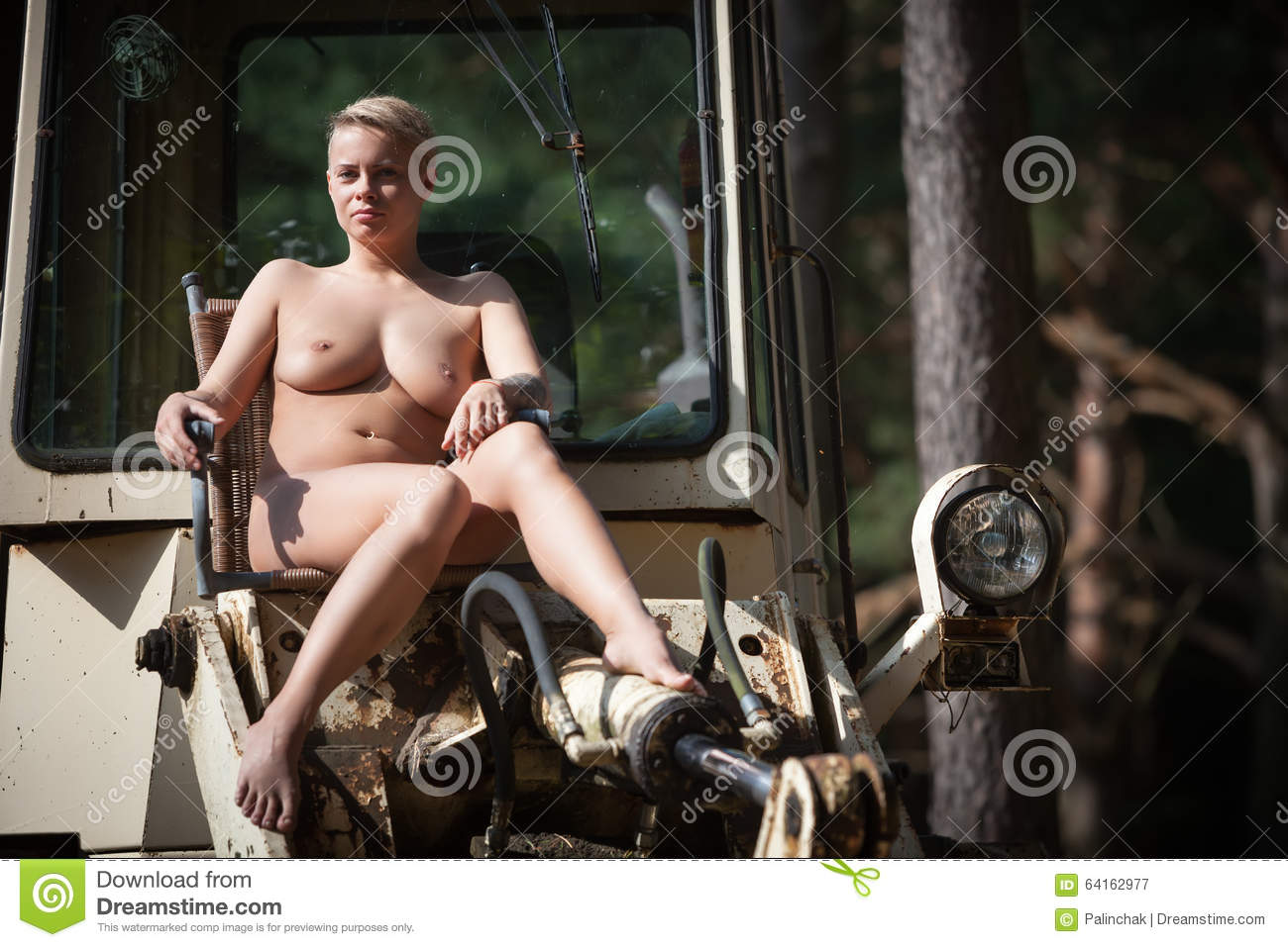 Something also posing naked on tractors pics were