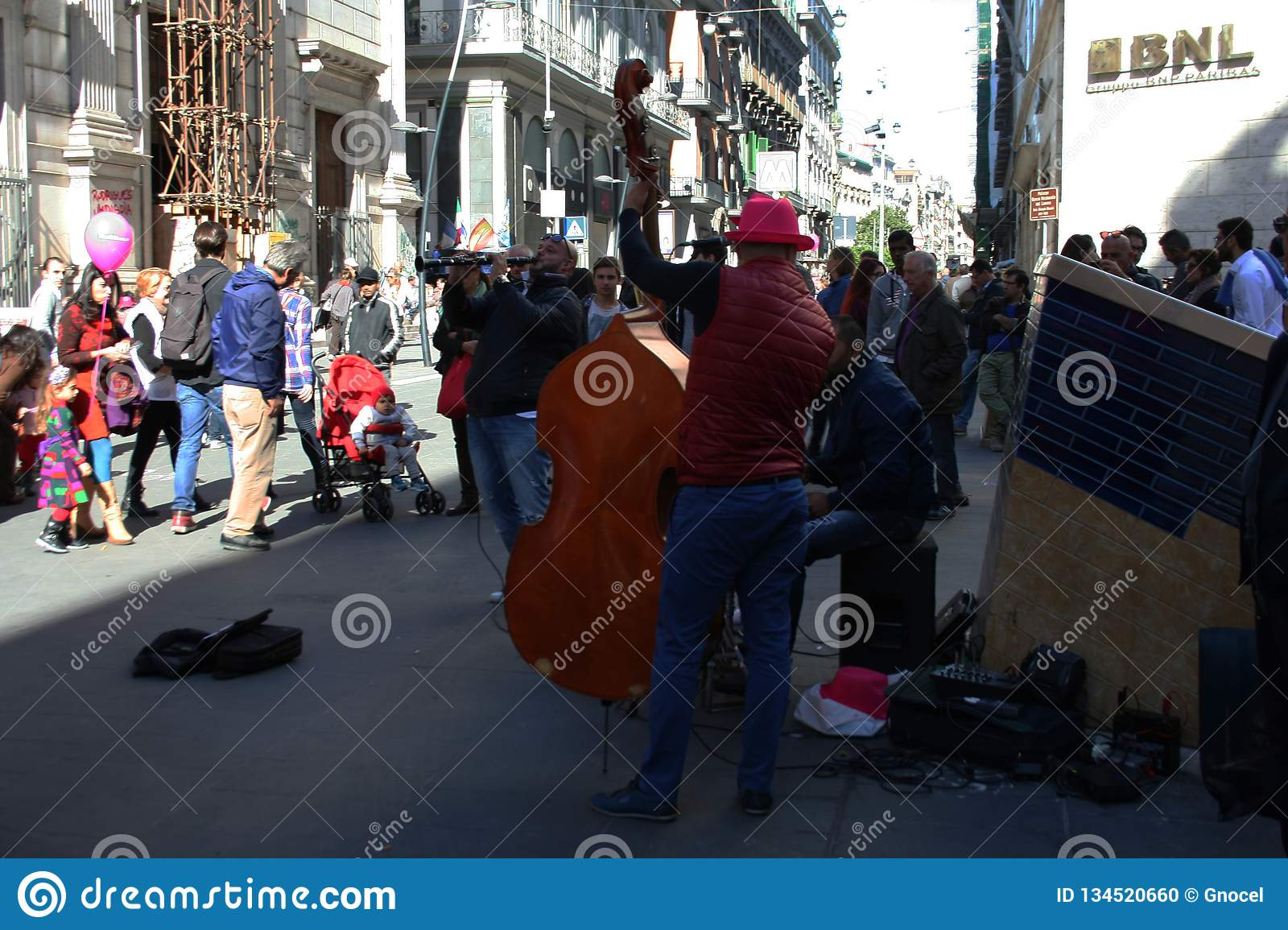 NAPLES, ITALY, October 2016 - Street musicians cheer up people with their music