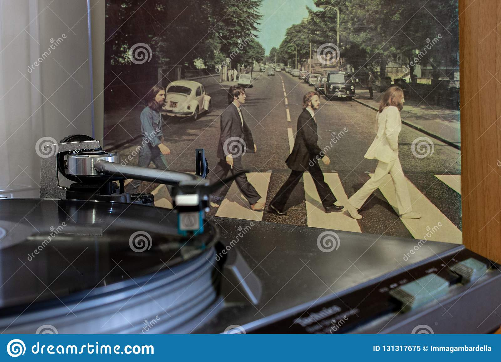 Naples, record player with the Beatles vinyls Abby Road on background.