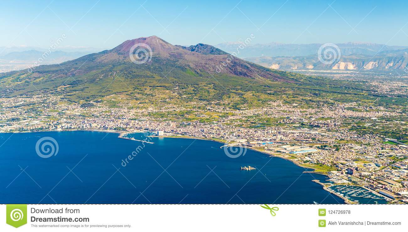 Napoli and mount Vesuvius in the background at sunrise in a summer day, Italy