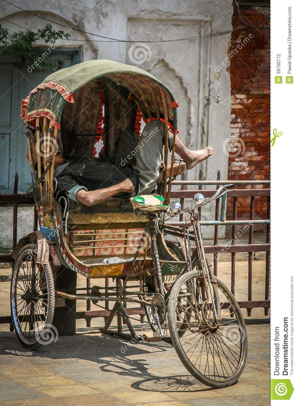 Napping in rickshaw