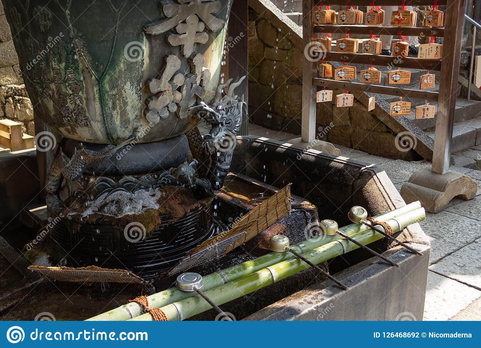 NARA, JAPAN - JAN 30, 2018: Dragon fountain for Chozuya water purification rite in temple of Osaka