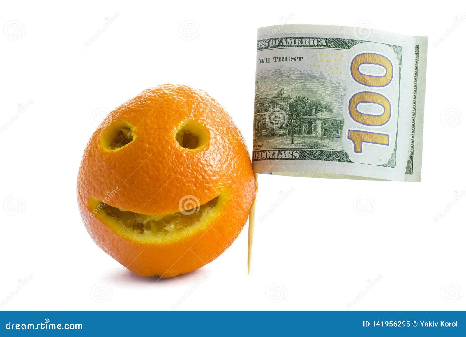 Naranja con una sonrisa y una bandera de los billetes de dólar del americano ciento El concepto de América, dólares del aumento d