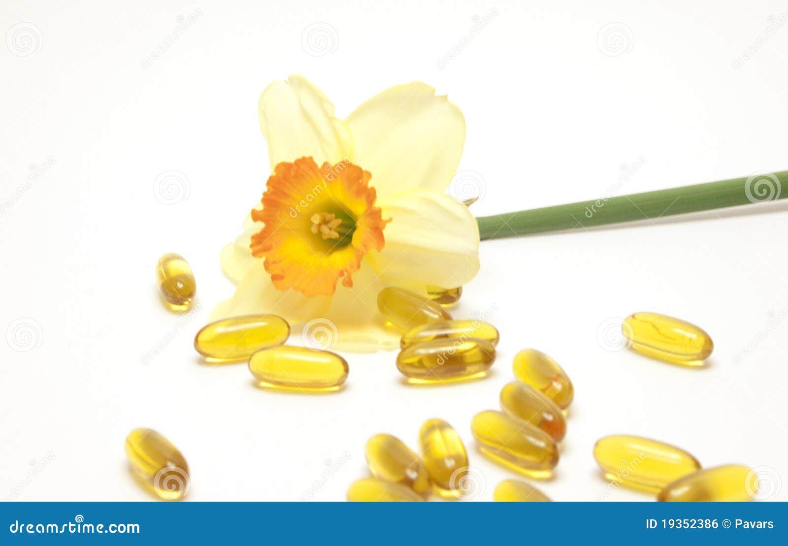 Narciso e comprimidos amarelos