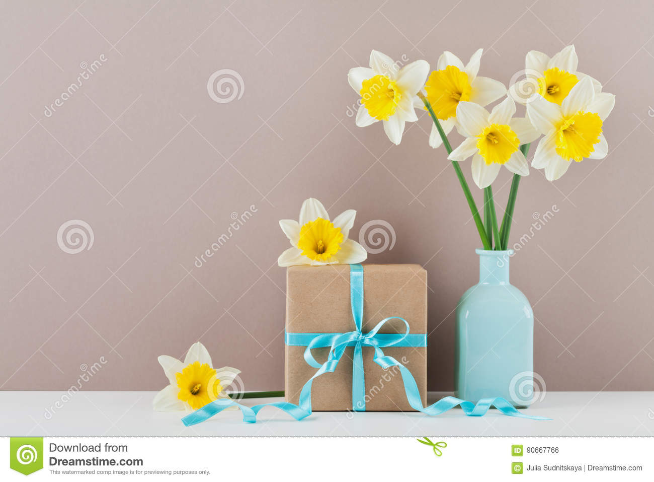 Narcissus Or Daffodil Flowers In Vase And Gift Box For Greeting On