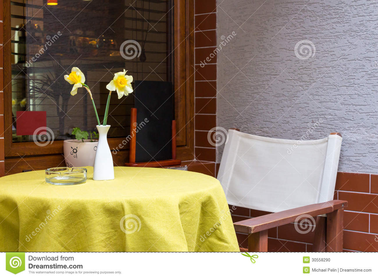 Narcissus flower in a vase in a cafe stock photo image 30558290 royalty free stock photo reviewsmspy