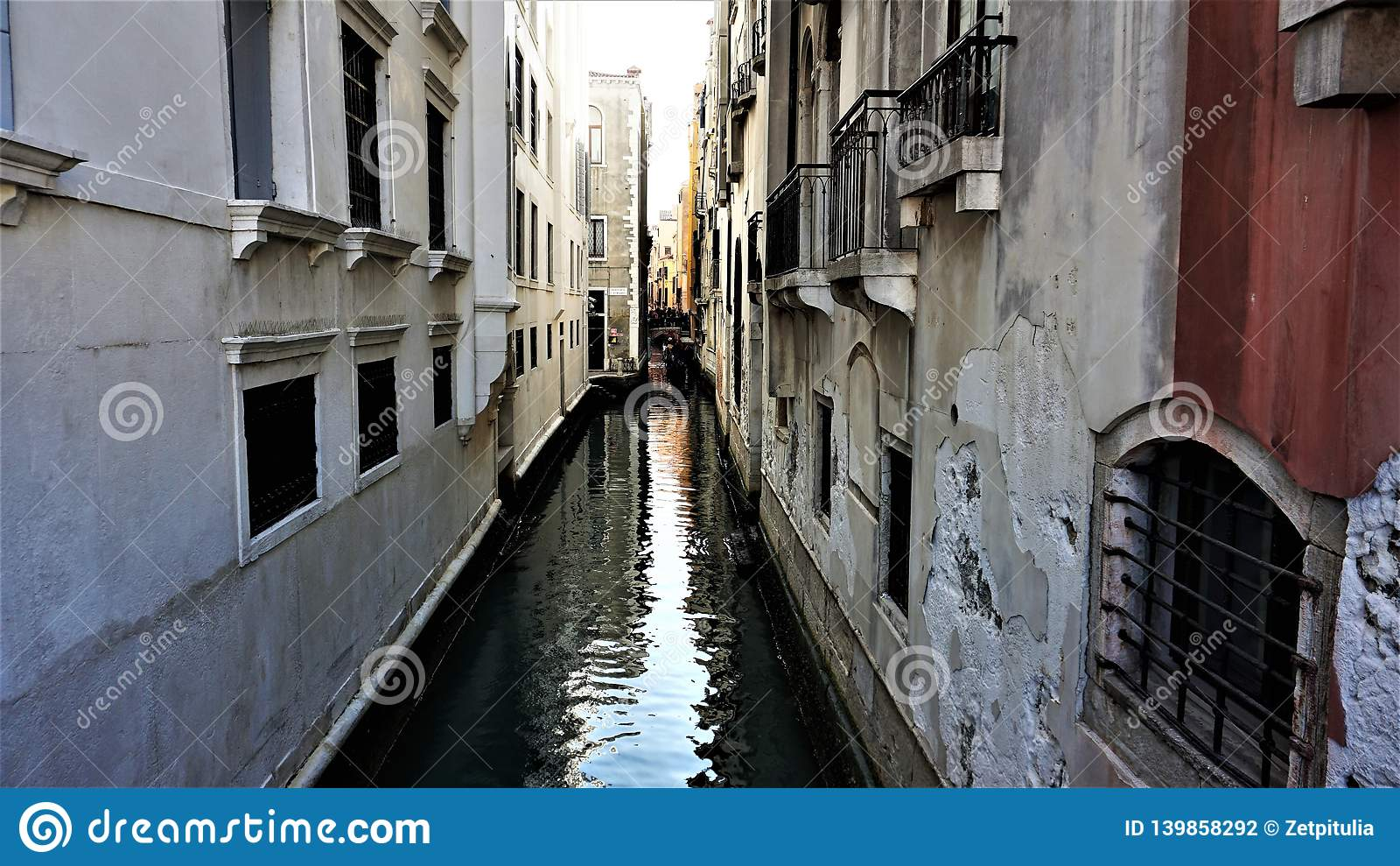 Narrow canal, between the whites and the kiln houses of Venice, Italy