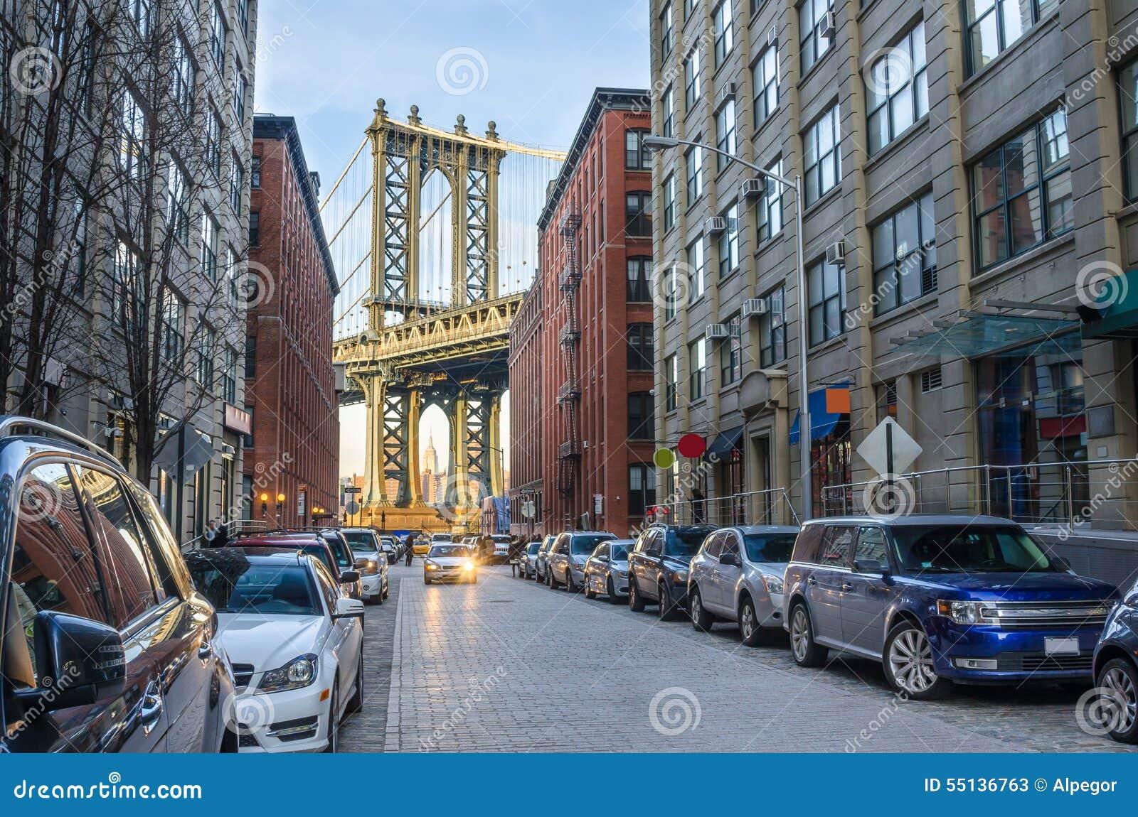 Narrow Cobbled Street with Manhattan Bridge in Background