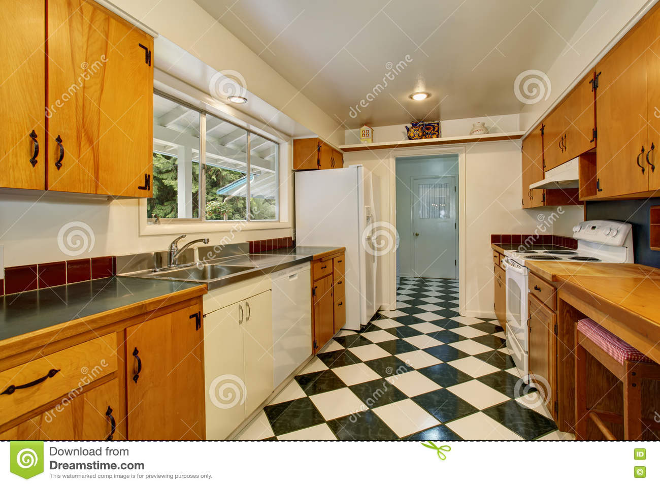 Narrow Kitchen Room Interior With Light Brown Cabinets White And Black Tile Stock Photo Image Of Shiny Kitchen 74850962