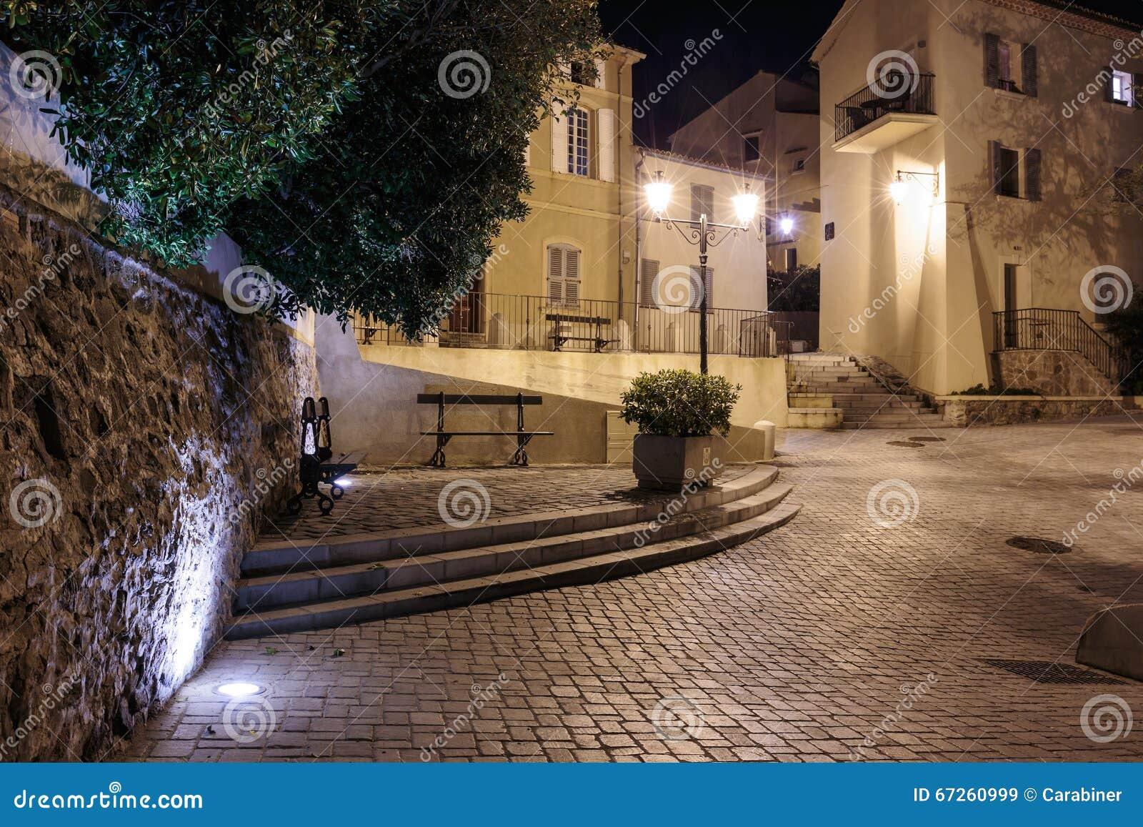 Narrow old street at night in Saint-Tropez.