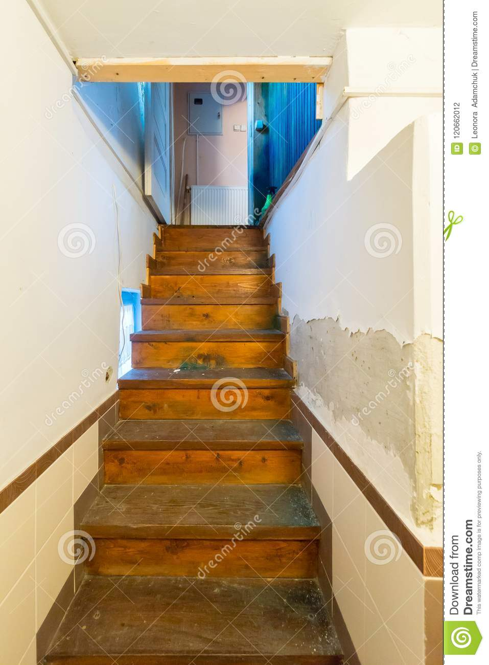 A Narrow Staircase In The Room Leading Up With Wooden Stairs Stock