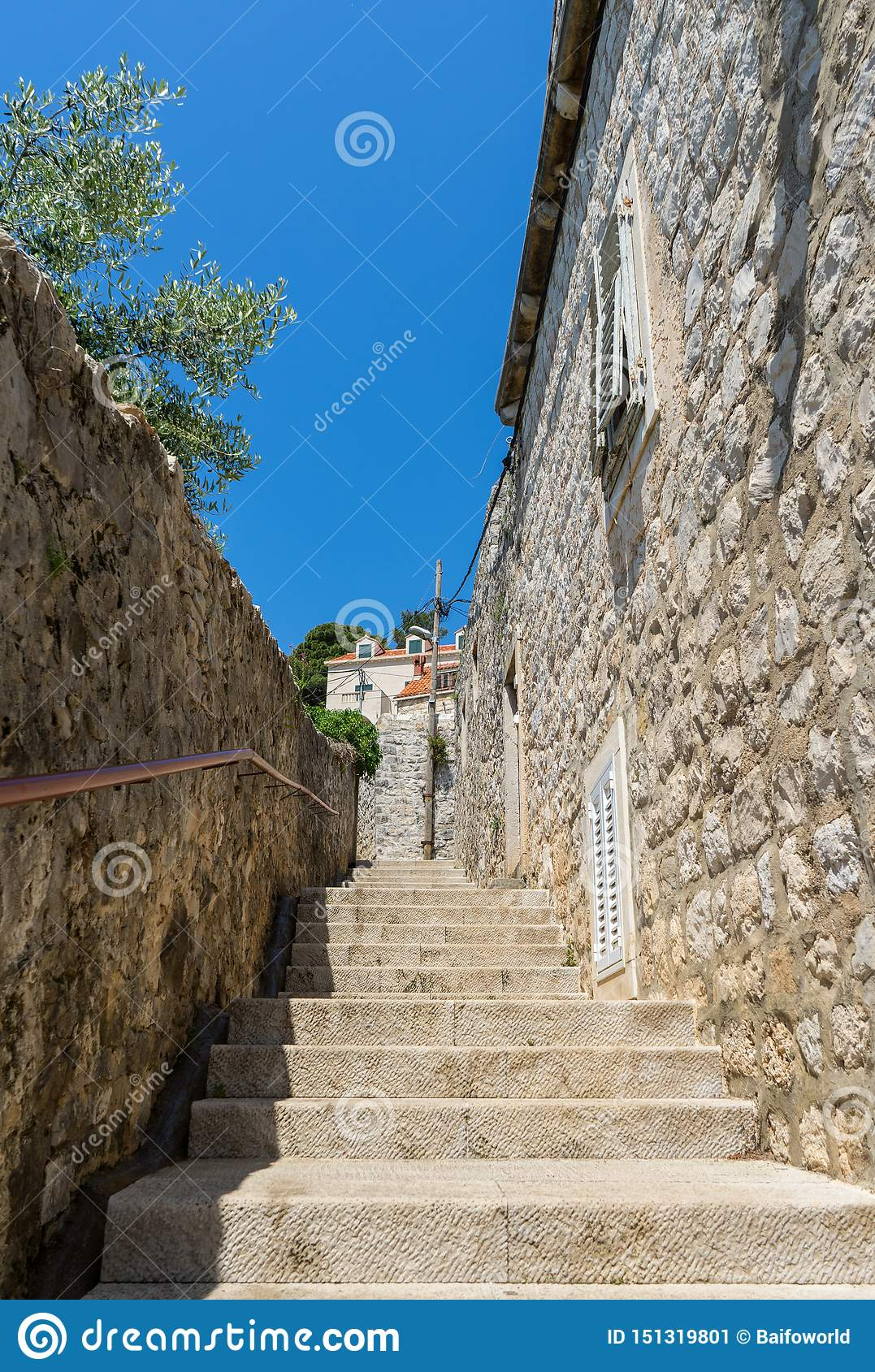 narrow stone stairs between old residential area in croatia. Adriatic coast village with stone houses and Old stone street of
