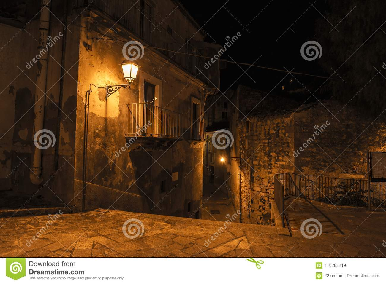 Street of the old town at night in Ragusa, Sicily, Italy