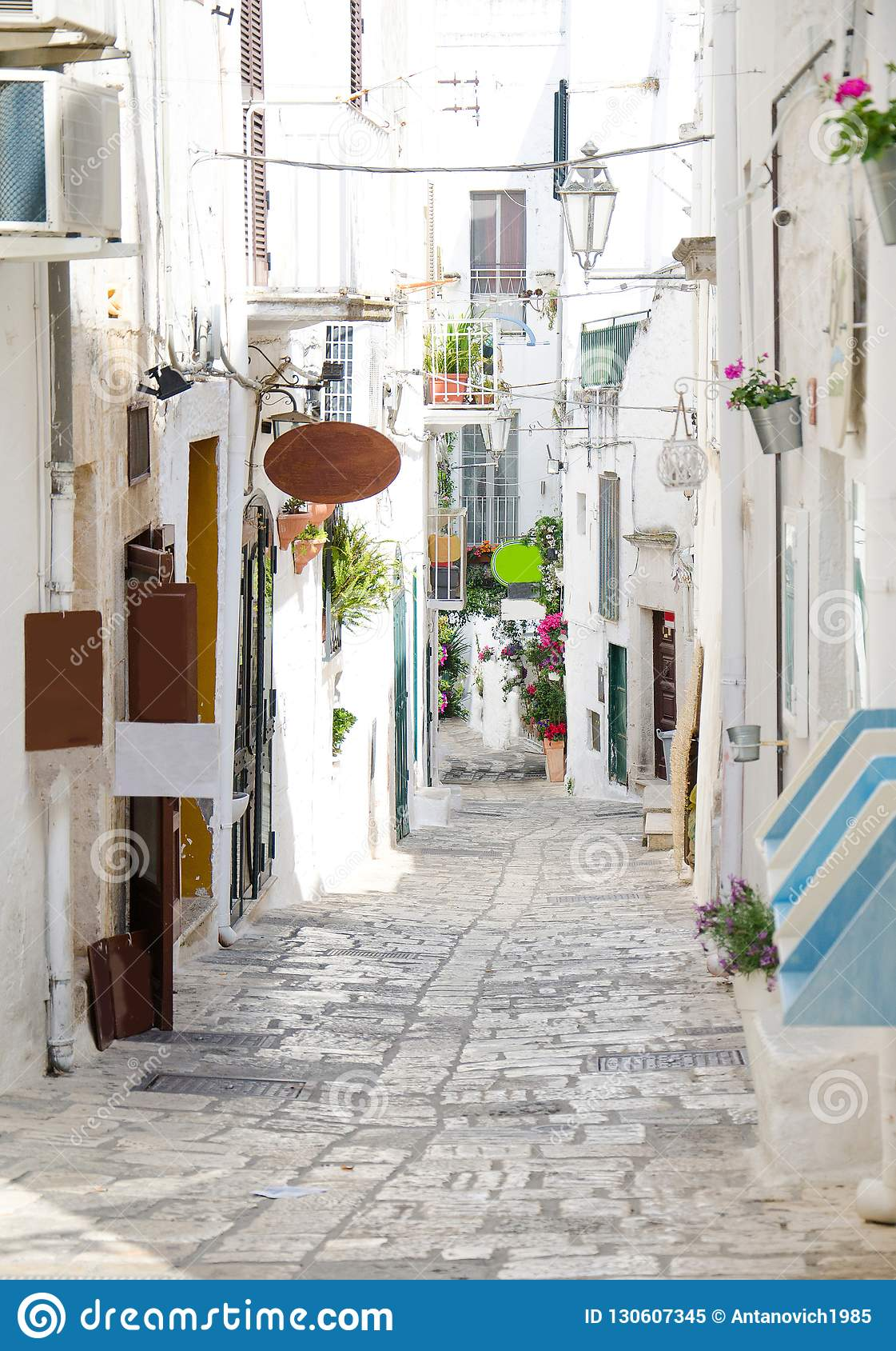 Narrow streets of Ostuni town with white buildings, Puglia, Ital