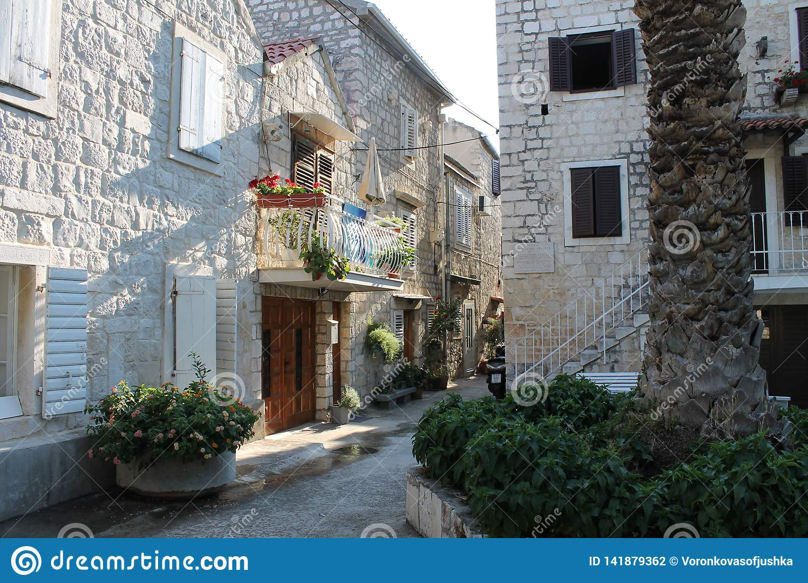 Narrow streets of Trogir, Croatia with white stone houses in the old town