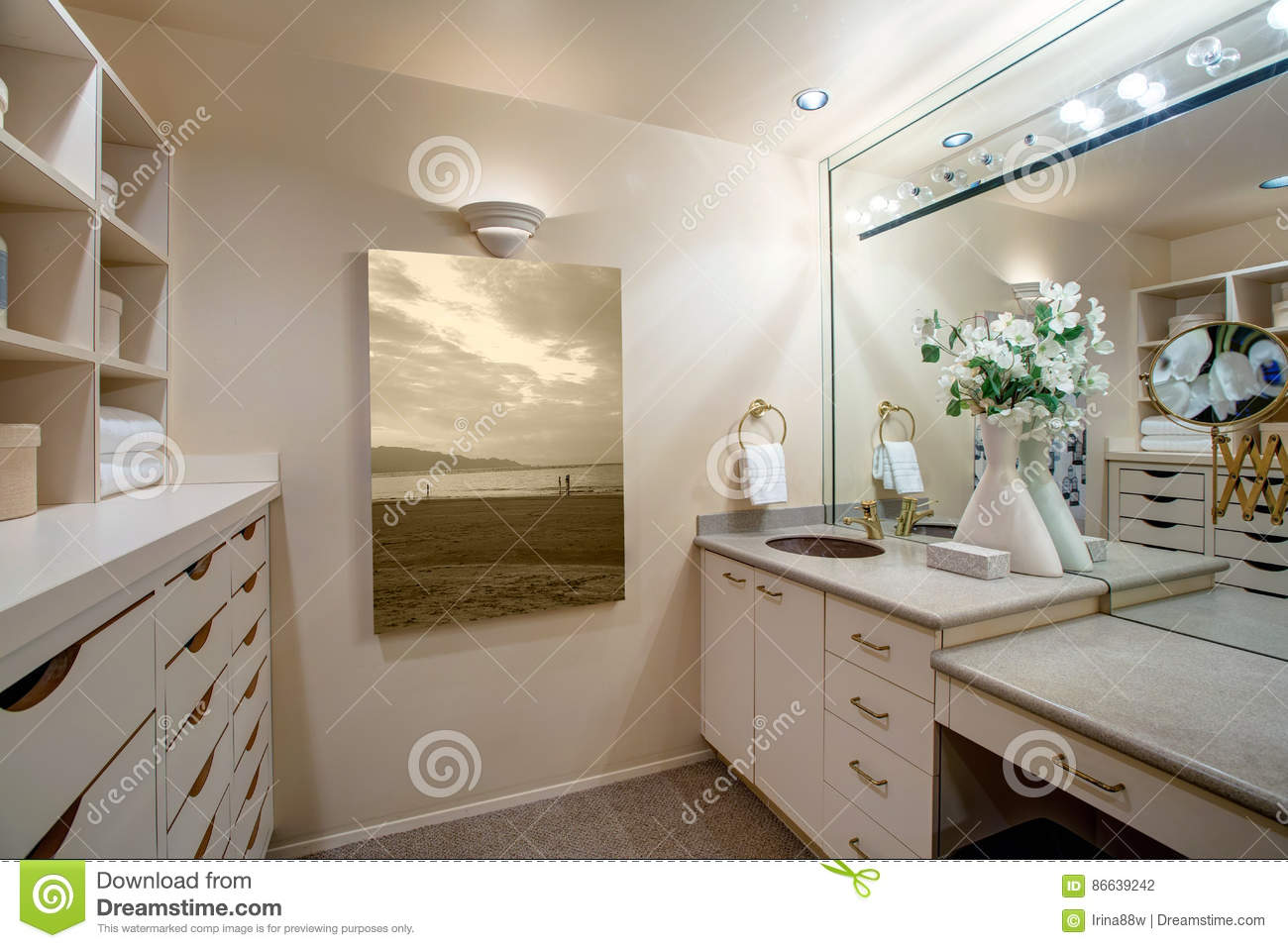 Narrow Walk In Closet Features Make Up Vanity Stock Photography