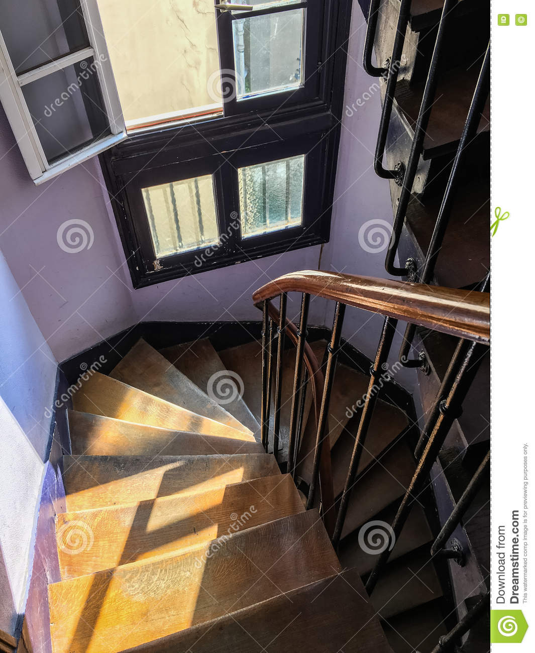 Narrow Wooden Spiral Staircase In Paris, France