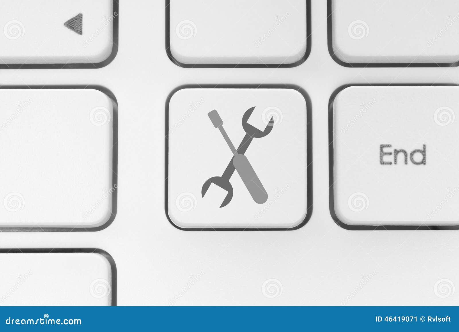 Narzędzie guzik na białej klawiaturze