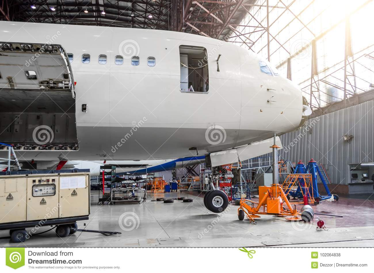 Download Nasal Part Of The Aircraft, The Cockpit, The Trunk, In The Hangar On Maintenance Repair. Stock Photo - Image of airliner, detail: 102064838