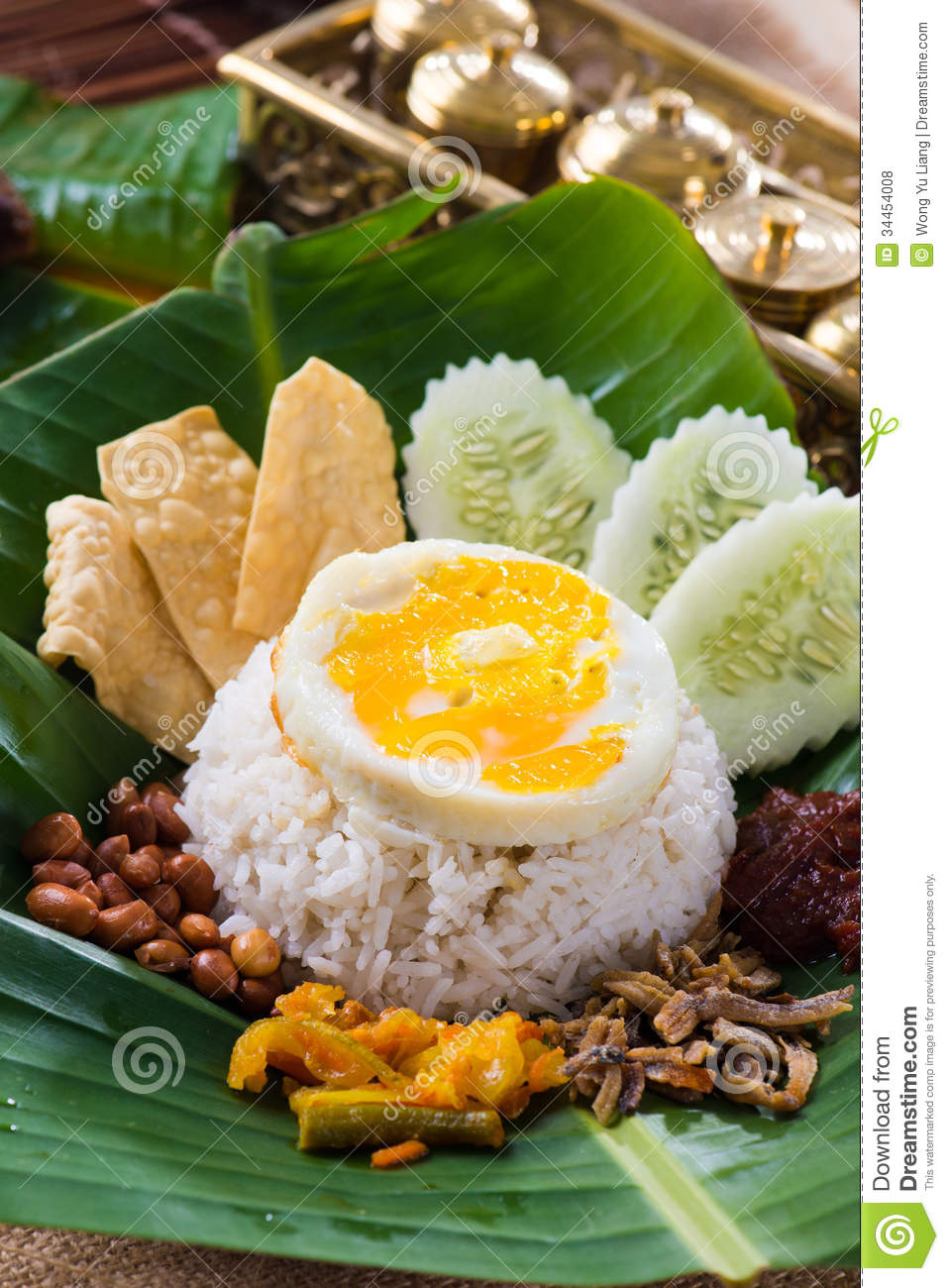 Nasi Lemak, A Traditional Malay Curry Paste Rice Dish Served On Stock Photo - Image of delicious