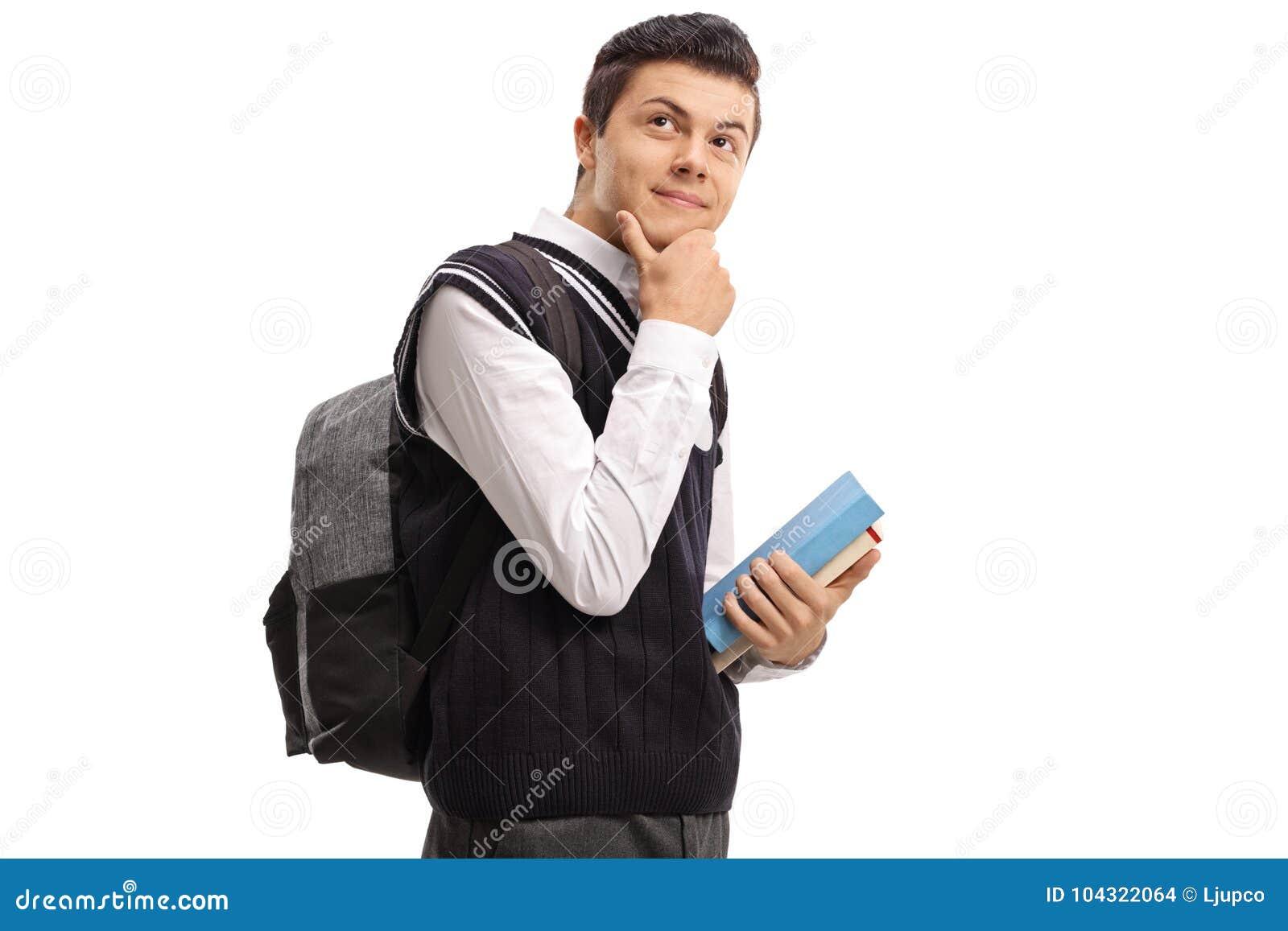 Nastoletni uczeń z plecaka i książek myśleć