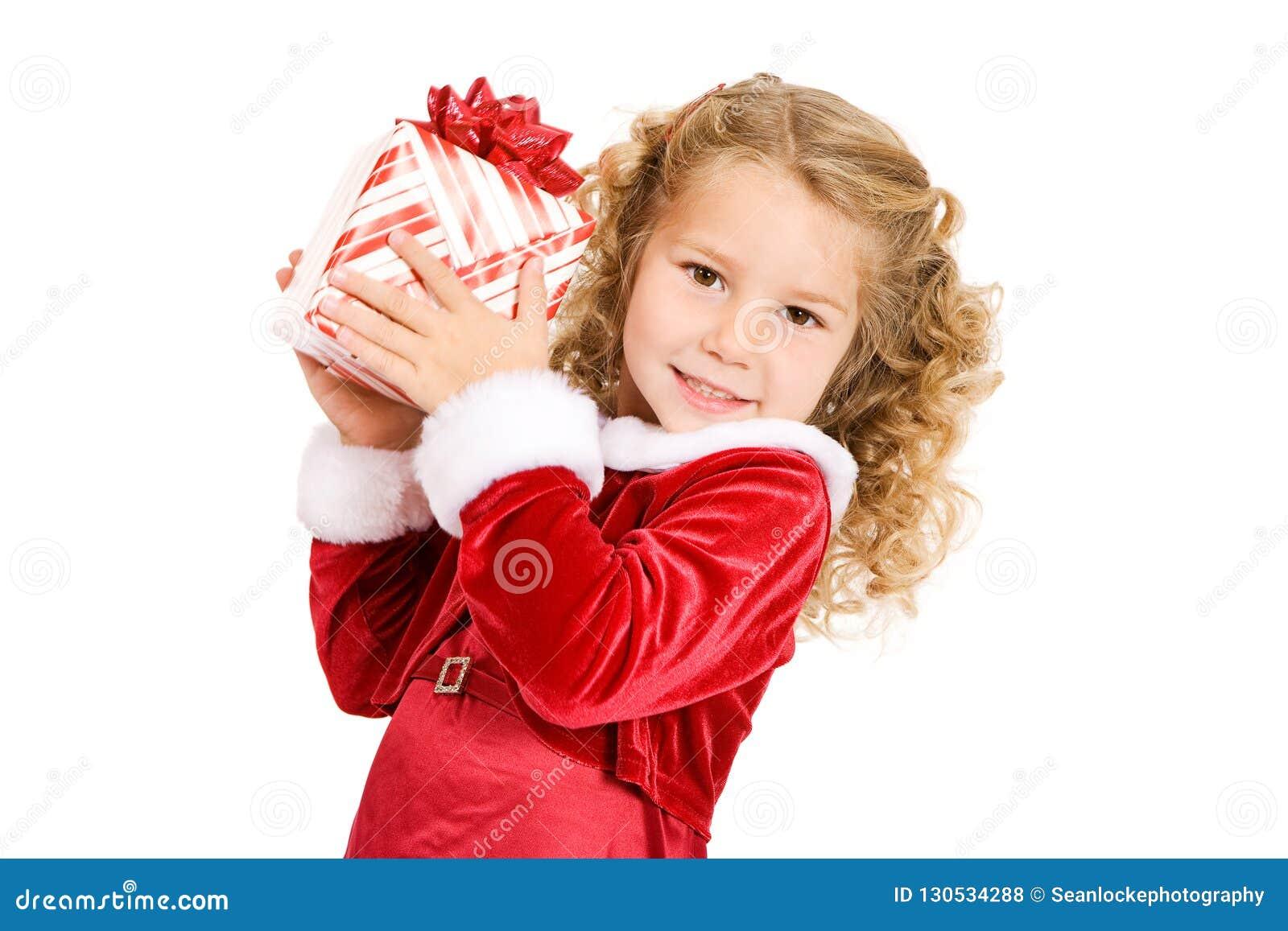 Natal: A menina sustenta o presente e as agitações de Natal para supor W