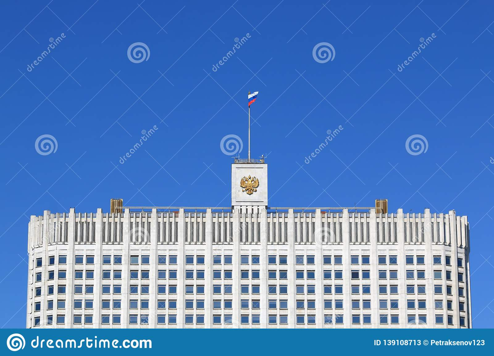 The House of the Government of the Russian Federation upper part, the State flag of Russia and the double-headed eagle