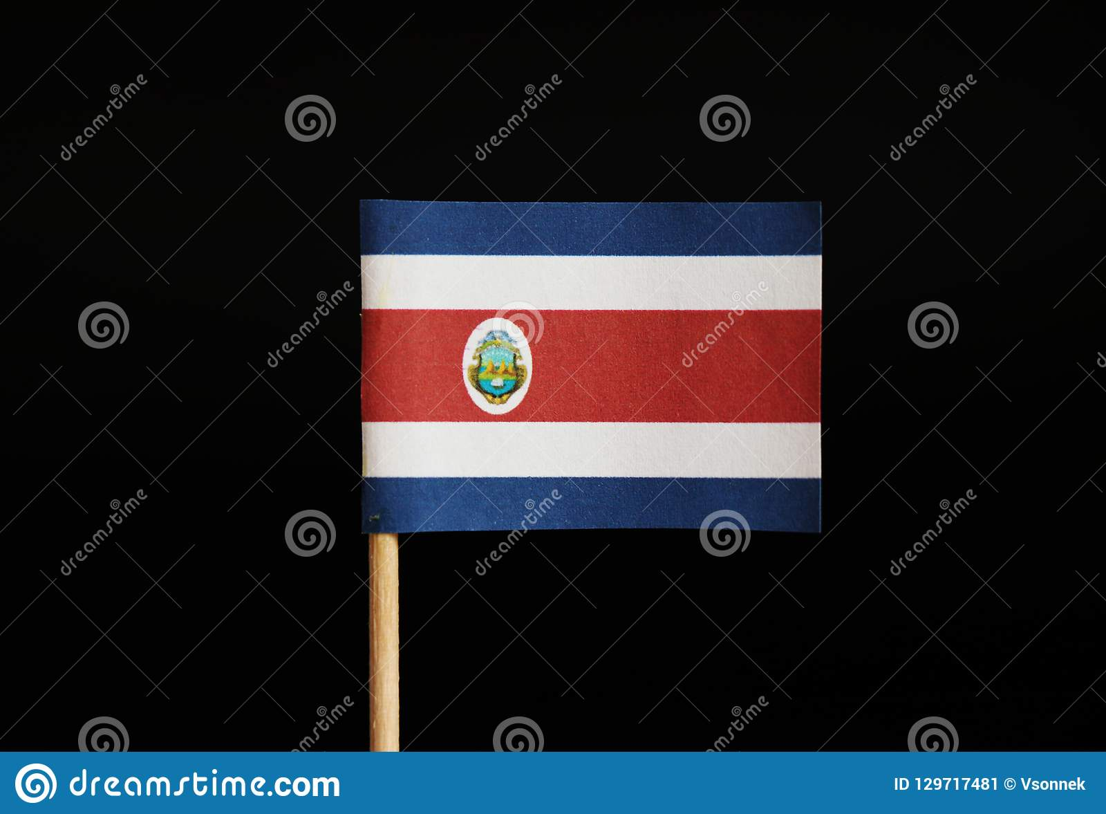 The national flag of the republic Costa Rica on toothpick and on black background. Located in central america.